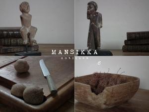 木彫の像とキッチンアイテム