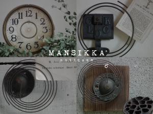 古い振り子時計のパーツ