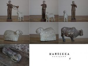 古い木彫りの動物と聖人