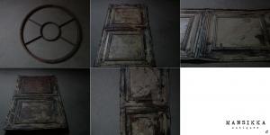 シャビーな円形鉄窓と壁面装飾