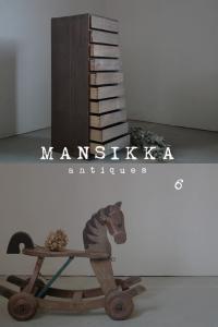 木製の収納家具と木馬